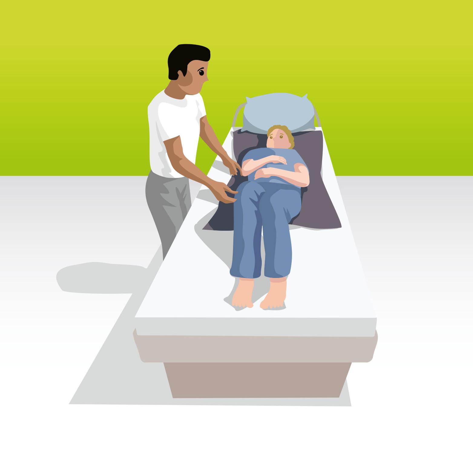 Umlagerung mit Hilfe einer Gleitmatte durch eine Pflegekraft